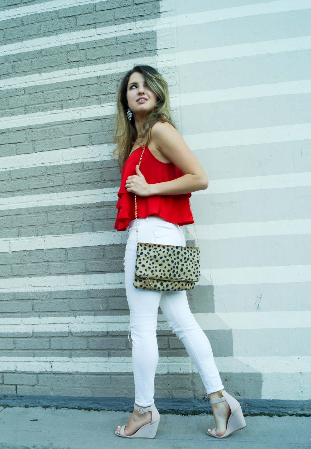 White jeans, red cami and cheetah print clutch